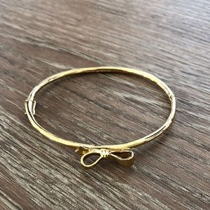 Kate Spade Bow Bracelet in Gold